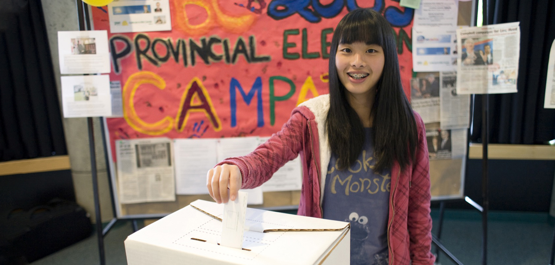 Student submitting their ballot